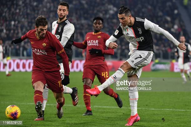 Juventus' Portuguese forward Cristiano Ronaldo shoots on goal despite AS Roma's Italian defender Davide Santon during the Italian Cup round of 8...