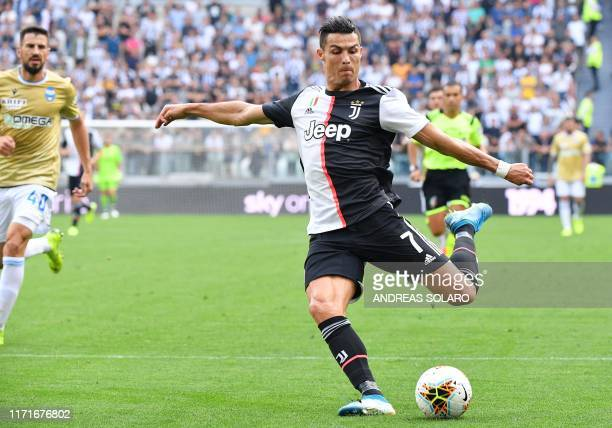 Juventus' Portuguese forward Cristiano Ronaldo shoots on goal during the Italian Serie A football match Juventus vs Spal on September 28, 2019 at the...