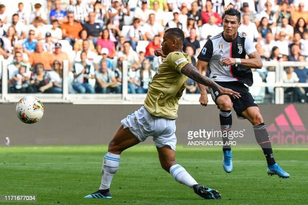Juventus' Portuguese forward Cristiano Ronaldo shoots on goal during the Italian Serie A football match Juventus vs Spal on September 28 2019 at the...