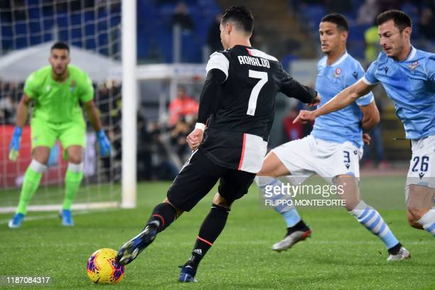 Juventus' Portuguese forward Cristiano Ronaldo shoots on goal during the Italian Serie A football match lazio Rome vs Juventus Turin on December 7...