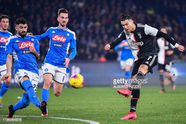 Juventus' Portuguese forward Cristiano Ronaldo shoots on goal during the Italian Serie A football match Napoli vs Juventus on January 26, 2020 at the...