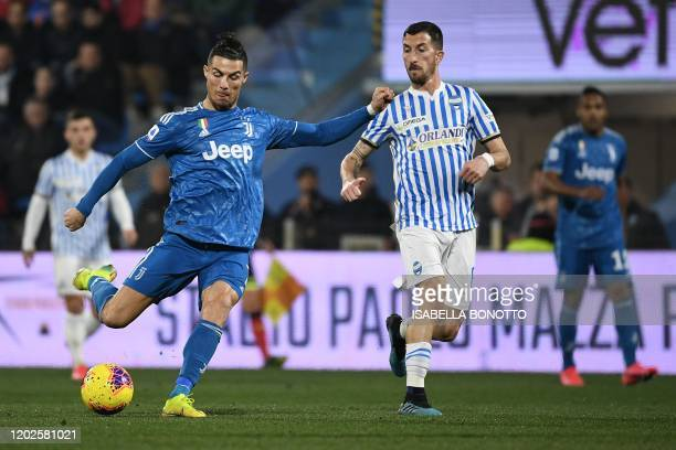 Juventus' Portuguese forward Cristiano Ronaldo shoots on goal during the Italian Serie A football match SPAL vs Juventus on February 22, 2020 at the...
