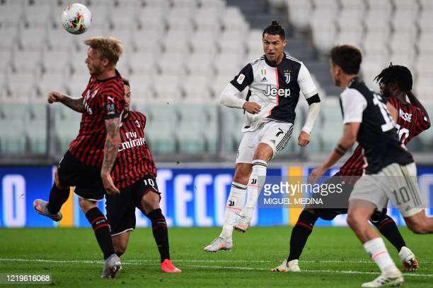 Juventus' Portuguese forward Cristiano Ronaldo shoots on goal during the Italian Cup semifinal second leg football match Juventus vs AC Milan on June...
