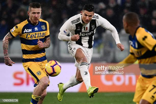 Juventus' Portuguese forward Cristiano Ronaldo shoots past Parma's Slovakian midfielder Juraj Kucka during the Italian Serie A football match...