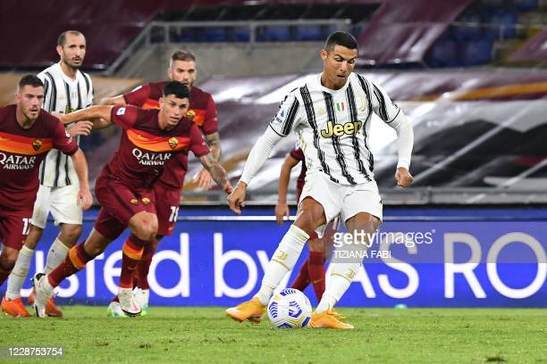 Juventus' Portuguese forward Cristiano Ronaldo shoots to score a penalty and equalize 1-1 during the Italian Serie A football match Roma vs Juventus...