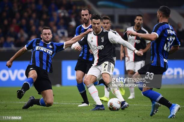 Juventus' Portuguese forward Cristiano Ronaldo shoots to score a goal that was later rescinded during the Italian Serie A football match Inter vs...