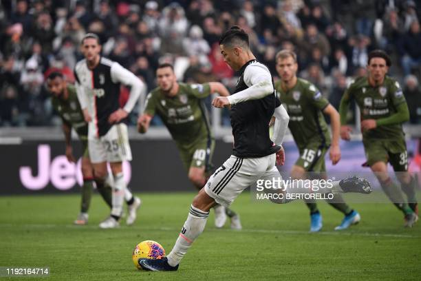 Juventus' Portuguese forward Cristiano Ronaldo shoots to score a penalty during the Italian Serie A football match Juventus vs Cagliari on January 6,...