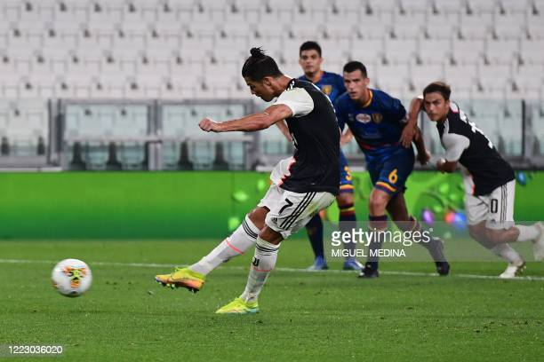 Juventus' Portuguese forward Cristiano Ronaldo shoots to score a penalty during the Italian Serie A football match Juventus vs Lecce played on June...