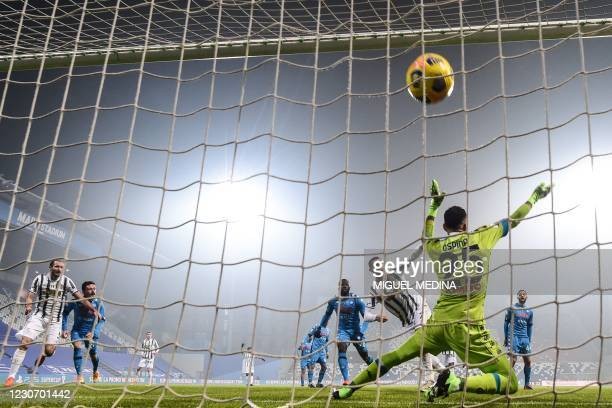 Juventus' Portuguese forward Cristiano Ronaldo shoots to score and open the scoring past Napoli's Colombian goalkeeper David Ospina during the...
