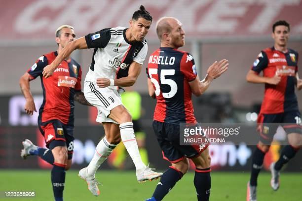 TOPSHOT Juventus' Portuguese forward Cristiano Ronaldo shoots to score during the Italian Serie A football match Genoa vs Juventus played on June 30...