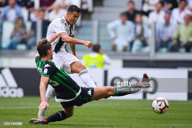Juventus' Portuguese forward Cristiano Ronaldo shoots to score his second goal during the Italian Serie A football match Juventus vs Sassuolo on...