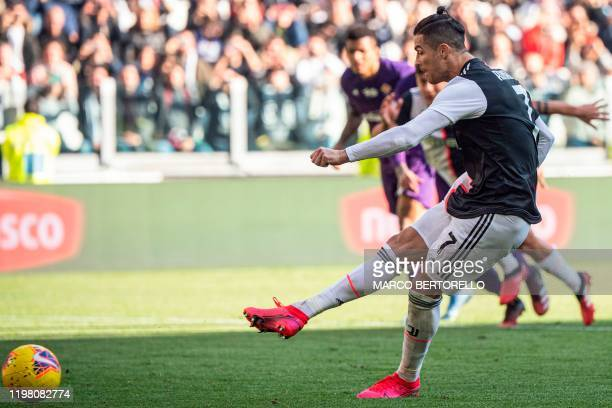 Juventus' Portuguese forward Cristiano Ronaldo shoots to score his second penalty and his 50th goal with Juventus during the Italian Serie A football...