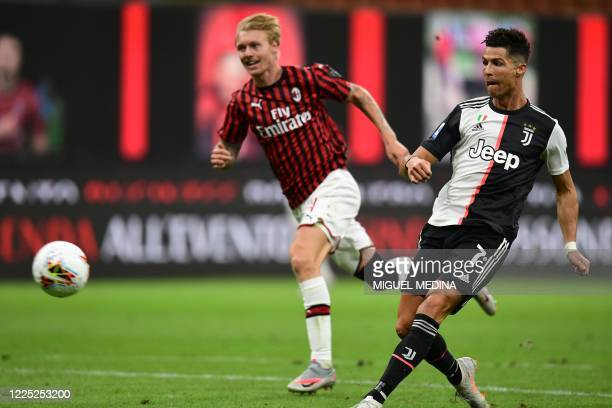 Juventus' Portuguese forward Cristiano Ronaldo shoots to score the second goal during the Italian Serie A football match AC Milan vs Juventus played...