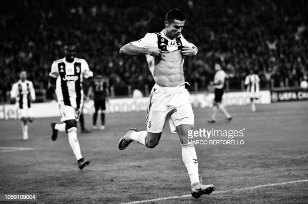 Juventus' Portuguese forward Cristiano Ronaldo shows his sixpack as he celebrates after opening the scoring during the UEFA Champions League group H...