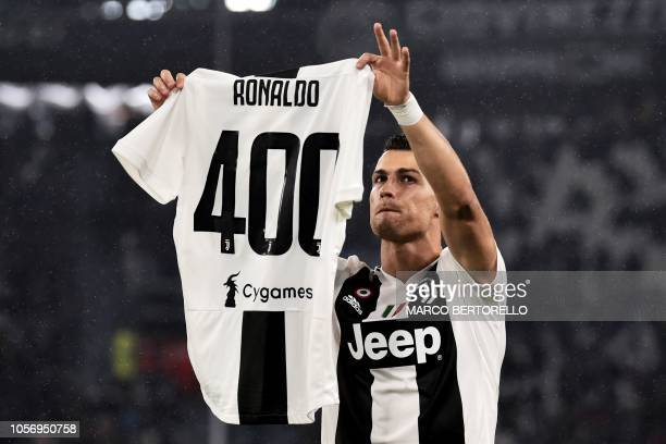 TOPSHOT Juventus' Portuguese forward Cristiano Ronaldo shows the celebrative jersey 400 during the Italian Serie A football match between Juventus...