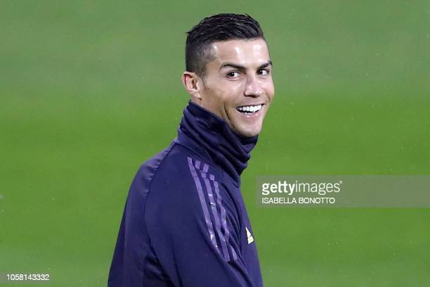 Juventus' Portuguese forward Cristiano Ronaldo smiles during a training session at the Contassina training ground in Turin on November 6 2018 on the...