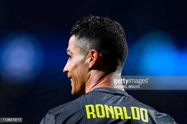 Juventus' Portuguese forward Cristiano Ronaldo smiles during the UEFA Champions League round of 16 first leg football match between Club Atletico de...