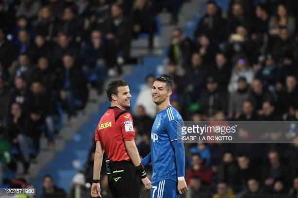 Juventus' Portuguese forward Cristiano Ronaldo smiles next to Italien referee Federico La Penna during the Italian Serie A football match SPAL vs...