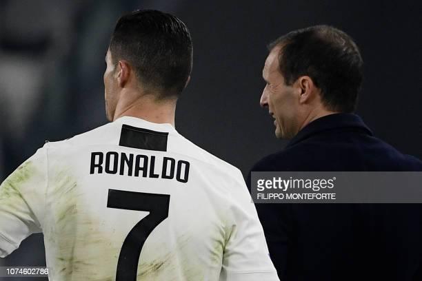 Juventus' Portuguese forward Cristiano Ronaldo talks with Juventus' Italian coach Massimiliano Allegri during the Italian Serie A Football match...