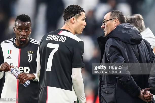 Juventus' Portuguese forward Cristiano Ronaldo talks with Juventus' Italian coach Maurizio Sarri as Juventus' French midfielder Blaise Matuidi looks...