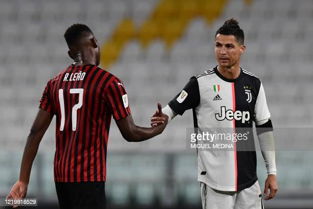 Juventus' Portuguese forward Cristiano Ronaldo taps hand with AC Milan's Portuguese forward Rafael Leao at the end of the Italian Cup semifinal...