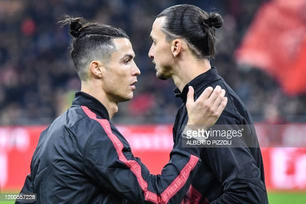 Juventus' Portuguese forward Cristiano Ronaldo taps the shoulder of AC Milan's Swedish forward Zlatan Ibrahimovic prior to the Italian Cup semifinal...