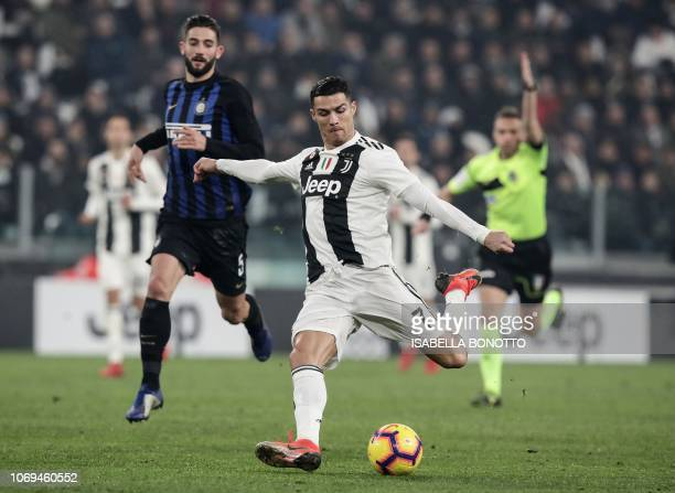 Juventus' Portuguese forward Cristiano Ronaldo vies for the ball with Inter Milan's Italian midfielder Roberto Gagliardini during the Serie A...