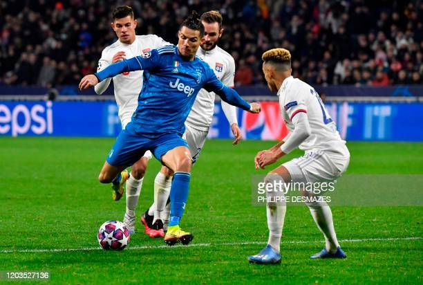 Juventus' Portuguese forward Cristiano Ronaldo vies for the ball with Lyon's French midfielder Lucas Tousart and Lyon's Brazilian defender Marcal...