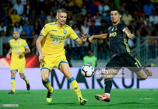 Juventus' Portuguese forward Cristiano Ronaldo vies with Frosinone Polish defender Bartosz Salamon during the Italian Serie A football match between...