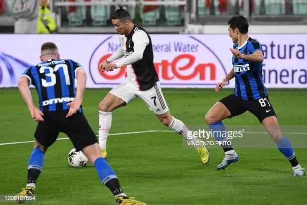 Juventus' Portuguese forward Cristiano Ronaldo vies with Inter Milan's Italian forward Antonio Candreva during the Italian Serie A football match...