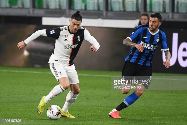 Juventus' Portuguese forward Cristiano Ronaldo vies with Inter Milan's Uruguayan midfielder Matias Vecino during the Italian Serie A football match...