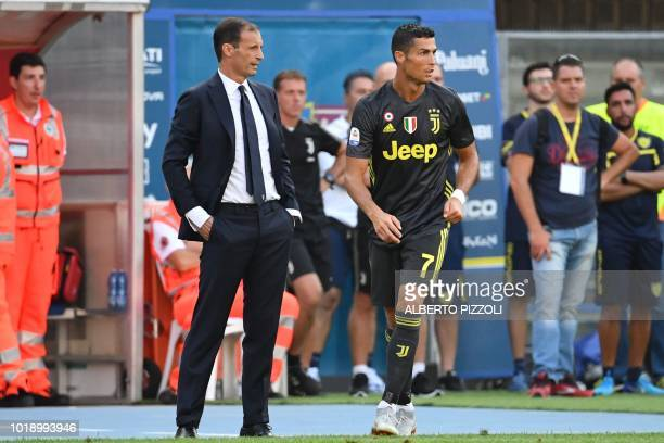 Juventus' Portuguese forward Cristiano Ronaldo walks by Juventus' head coach Massimiliano Allegri during the Italian Serie A football match AC Chievo...