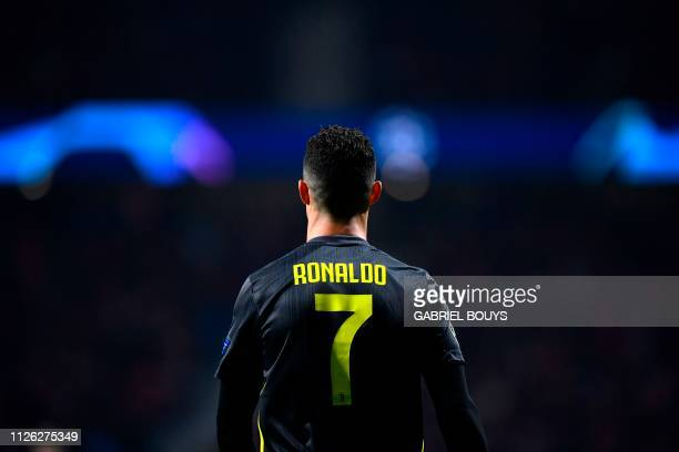 TOPSHOT Juventus' Portuguese forward Cristiano Ronaldo walks on the pitch during the UEFA Champions League round of 16 first leg football match...