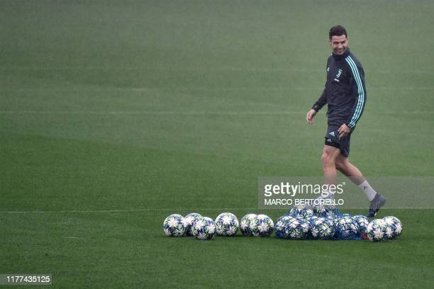 Juventus' Portuguese forward Cristiano Ronaldo walks past footballs during a training session on October 21 2019 at the Juventus Continassa Training...