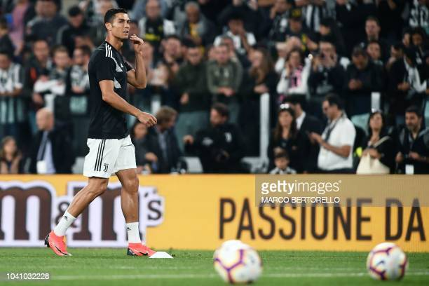 Juventus' Portuguese forward Cristiano Ronaldo warms up prior to the Italian Serie A football match between Juventus and Bologna on September 26 2018...