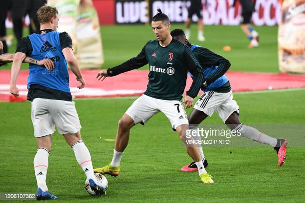 Juventus' Portuguese forward Cristiano Ronaldo warms up with teammates in the empty stadium as the match will be played behind closed doors due toi...
