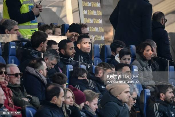 Juventus' Portuguese forward Cristiano Ronaldo watches from the substitutes' bench the Italian Serie A football Match Atalanta Bergamo vs Juventus on...