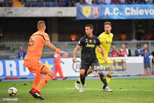 Juventus' Portuguese forward Cristiano Ronaldo watches the ball entering the goal after being shot by Juventus' midfielder Federico Bernardeschi...