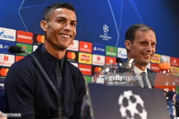 Juventus' Portuguese striker Cristiano Ronaldo and Juventus' manager Massimiliano Allegri attend a press conference at Old Trafford in Manchester...