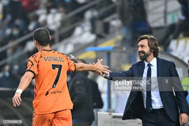 Juventus' Portuguese striker Cristiano Ronaldo celebrates with coach Andrea Pirlo after scoring during the Italian Serie A football match between...