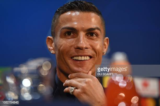 Juventus' Portuguese striker Cristiano Ronaldo smiles during a press conference at Old Trafford in Manchester north west England on October 22 on the...