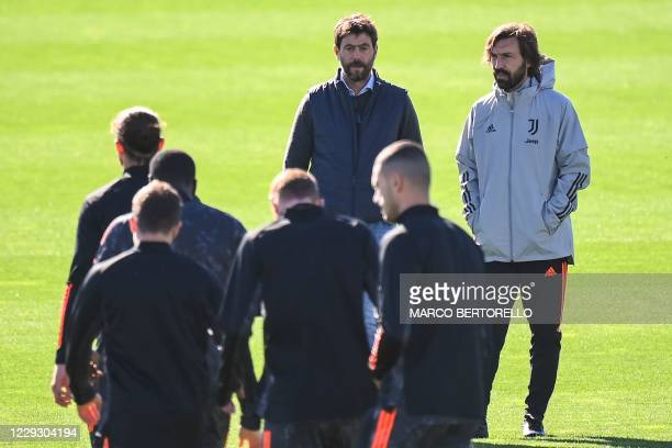 Juventus president Andrea Agnelli and Juventus coach Andrea Pirlo attend a training session on the eve of the UEFA Champions League football group G...