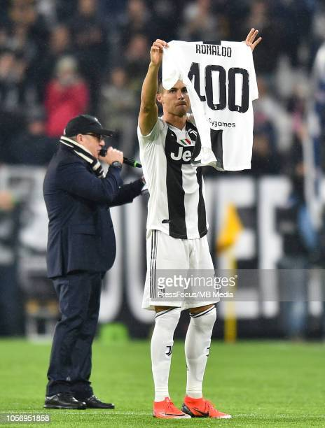 Juventus president Andrea Agnelli awards Cristiano Ronaldo a celebratory shirt for his 400 goals across the Serie A Premier League and the La Liga...