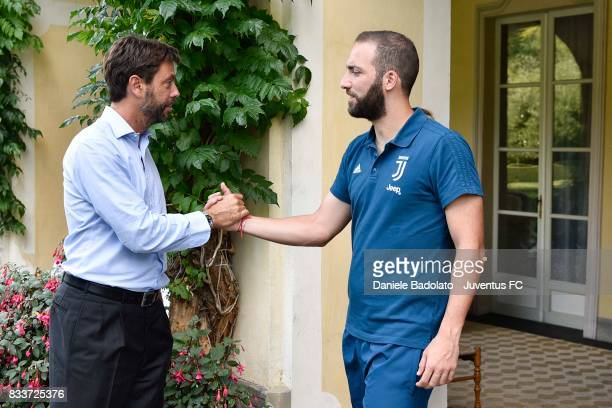 Juventus President Andrea Agnelli cheers Gonzalo Higuain before the preseason friendly match between Juventus A and Juventus B on August 17 2017 in...
