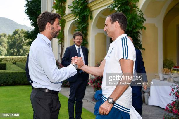 Juventus President Andrea Agnelli cheers head coach of Juventus Massimiliano Allegri before the preseason friendly match between Juventus A and...