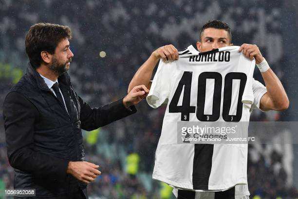 Juventus president Andrea Agnelli gives to Cristiano Ronaldo the trophy for his 400 goals realise in different European Championships before the...