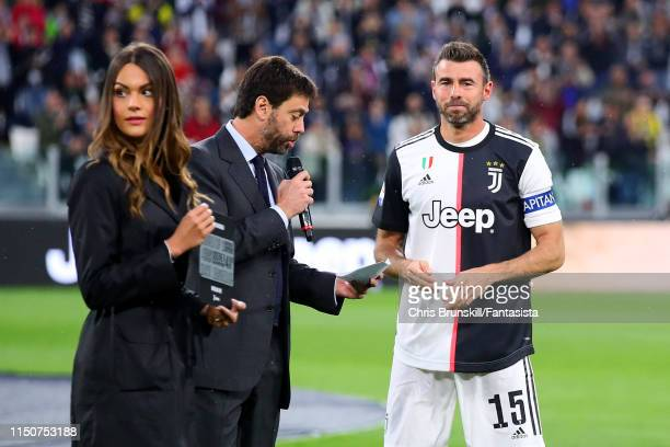 Juventus President Andrea Agnelli speaks to the crowd as Andrea Barzagli looks on ahead of the Serie A match between Juventus and Atalanta BC at...
