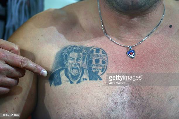 Juventus shows a tattoo of Alessandro Del Piero during the UEFA Champions League Round of 16 between Borussia Dortmund and Juventus at Signal Iduna...