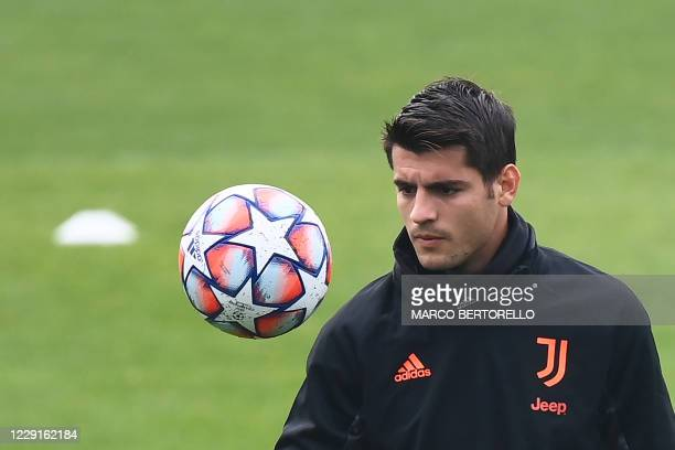 Juventus' Spanish forward Alvaro Morata attends the training session at the Juventus Training Center in Turin on the eve of the UEFA Champions League...