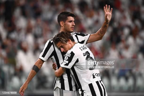 Juventus' Spanish forward Alvaro Morata celebrates after scoring a goal with Juventus' Italian midfielder Nicolo Fagioli during the friendly football...